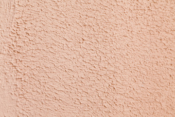 pink limestone textured wall background with selective focus