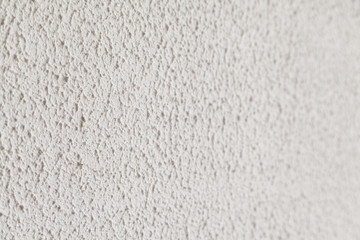 White limestone textured wall with selective focus