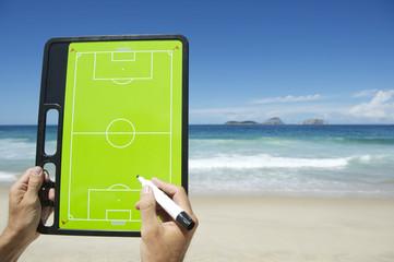 Hands Writing on Football Tactics Board Rio Beach Brazil