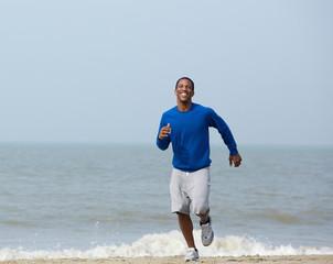 Healthy athletic man jogging