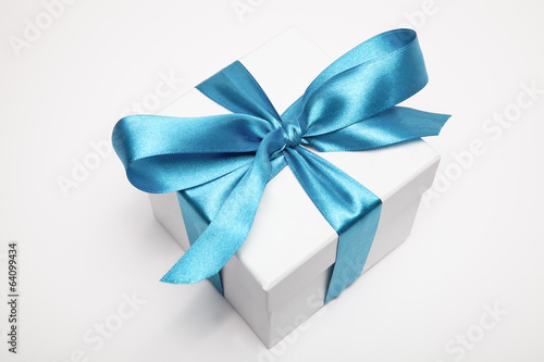 gift box with blue ribbon - 64099434