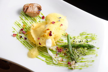 Fine dining, ravioli with asparagus and Porcini mushrooms