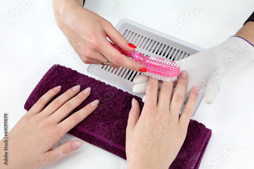 Beauty treatment of fingernails, brushing dust