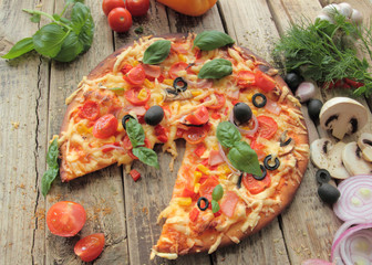 Pizza with fresh olives ham and tomatos