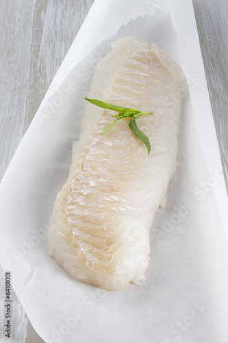 Fresh cod filet on baking paper