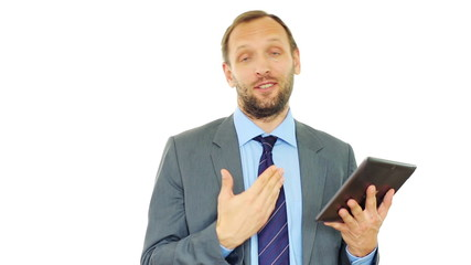 Successful businessman with tablet talking to camera, isolated