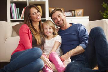 Portrait of loving family in living room