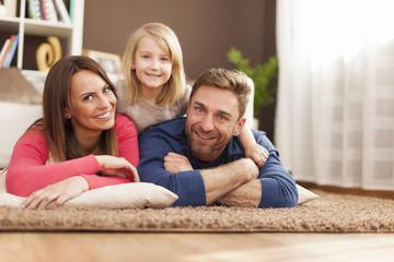 Portrait of loving family on carpet