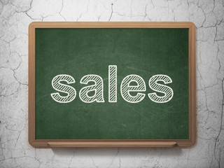 Advertising concept: Sales on chalkboard background