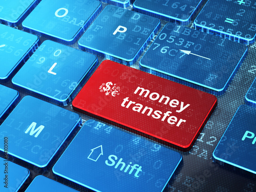Business concept: Finance Symbol and Money Transfer on computer