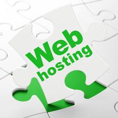 Web development concept: Web Hosting on puzzle background