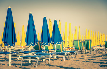 Umbrellas and sunbeds at Rimini Beach Italy - Vintage Retro