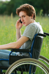disabled boy with mobile phone