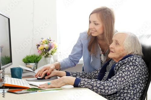 Elderly woman and teacher