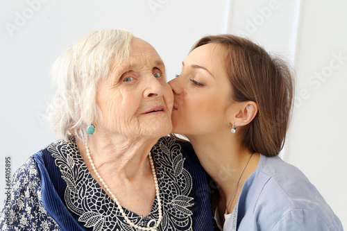 Elderly woman with granddaughter - 64105895