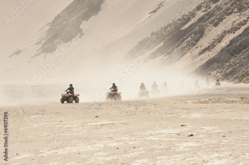 Quad bike safari through a desert landscape