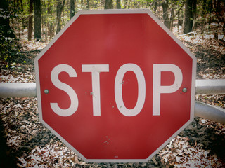A filtered photo background of stop sign on a rural road.