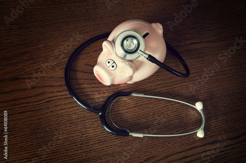 stethoscope piggy bank desk