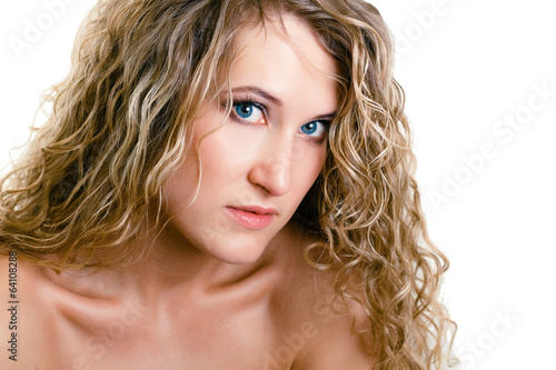 portrait of a beautiful young girl with long blond wavy hair