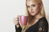 Beautiful woman drinking Coffee.Blond Girl with Cup of tea