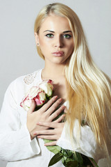 Beautiful Blond Woman with Roses.girl and Flowers.bouquet