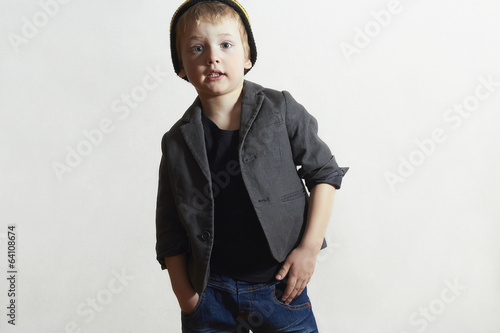 Fashionable little Boy in cap and jeans.Fashion Children