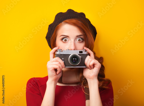 Redhead women with scarf and vintage camera