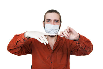the young man removing a medical rubber glove