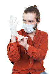the young man dressing a medical rubber glove