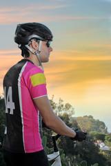 sportsman riding mountain bike