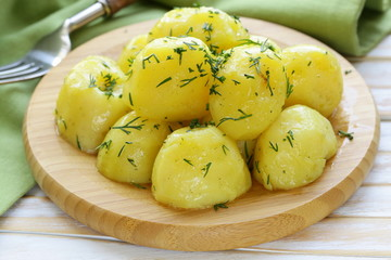 boiled fresh organic potatoes with the oil and dill