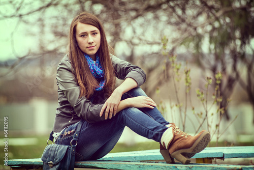 Attractive young girl enjoying a quiet moment
