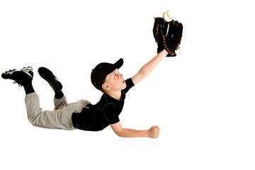 Young baseball player diving to catch fly ball