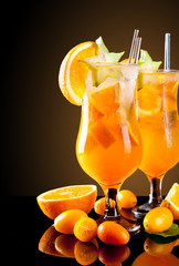 Fresh orange cocktails on black background