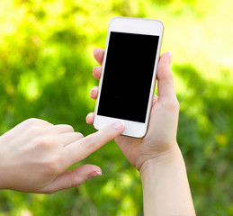 female hands holding a white phone