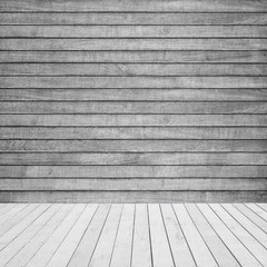 light gray stage with wooden floor and wall