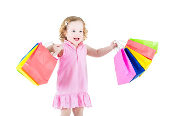 Little girl with colorful bags after successful sale shopping