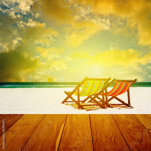 Beach chairs with summer sea and sunset sky