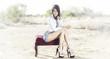 Beautiful woman long legs denim desert