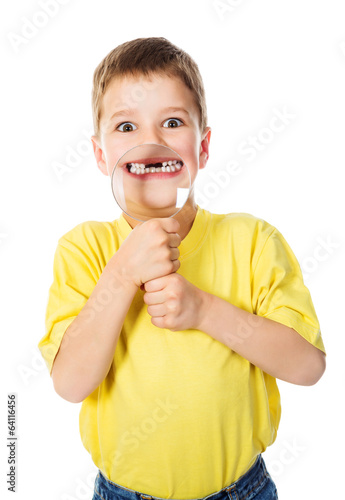 Boy showing teeth through a magnifying glass