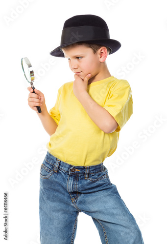 Boy in hat with magnifying glass