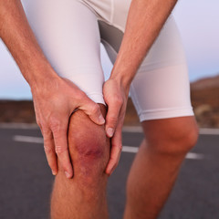Knee injury - athlete runner with sport injury
