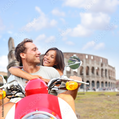 Rome couple on scooter by Colosseum, Italy