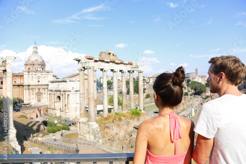 Roman Forum tourists looking at landmark in Rome