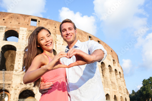 Romantic travel couple in Rome by Colosseum, Italy