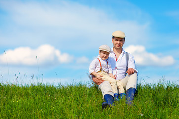 happy father and son on the green field