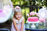 Fototapety Little girl celebrate Happy Birthday Party with rose outdoor