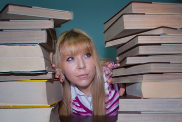 female student tired of reading books for exams