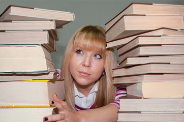 female student has too many books to read before exams