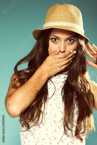 picture of surprised woman face hand over mouth